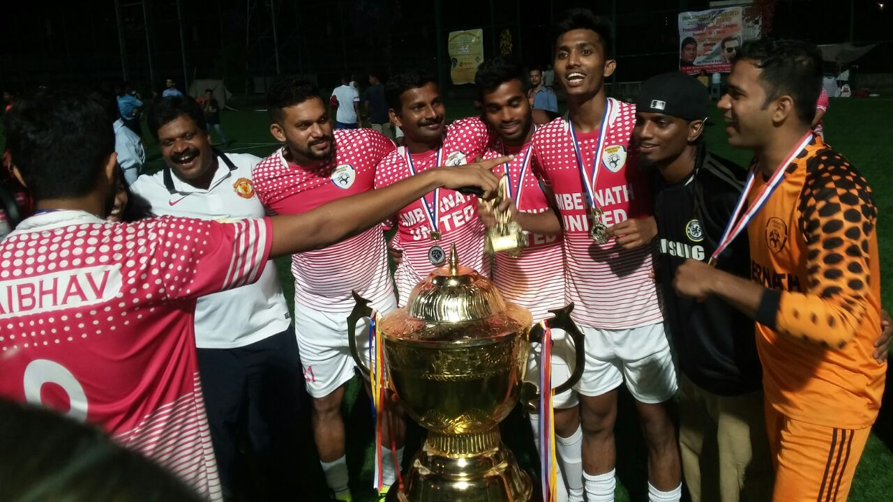 Third from right, Farukh Choudhary celebrating after winning the tournament with local club Ambernath United.